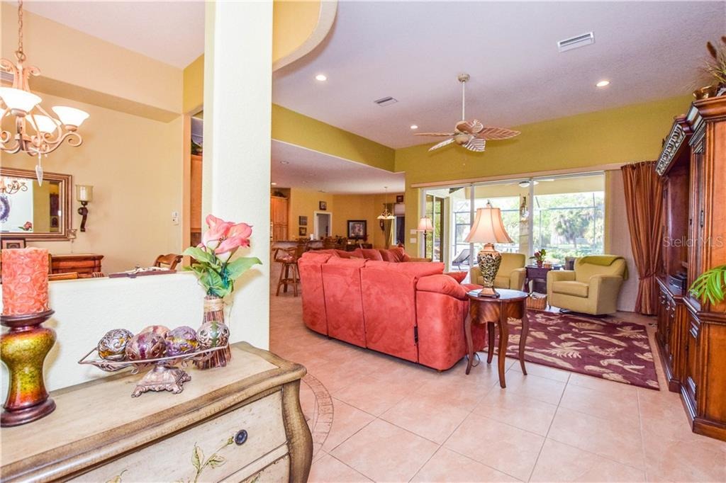 View of great room from foyer. - Single Family Home for sale at 2560 Pebble Creek Pl, Port Charlotte, FL 33948 - MLS Number is N6109100