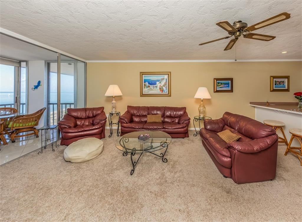 Living room - Condo for sale at 555 The Esplanade N #1004, Venice, FL 34285 - MLS Number is N6109326