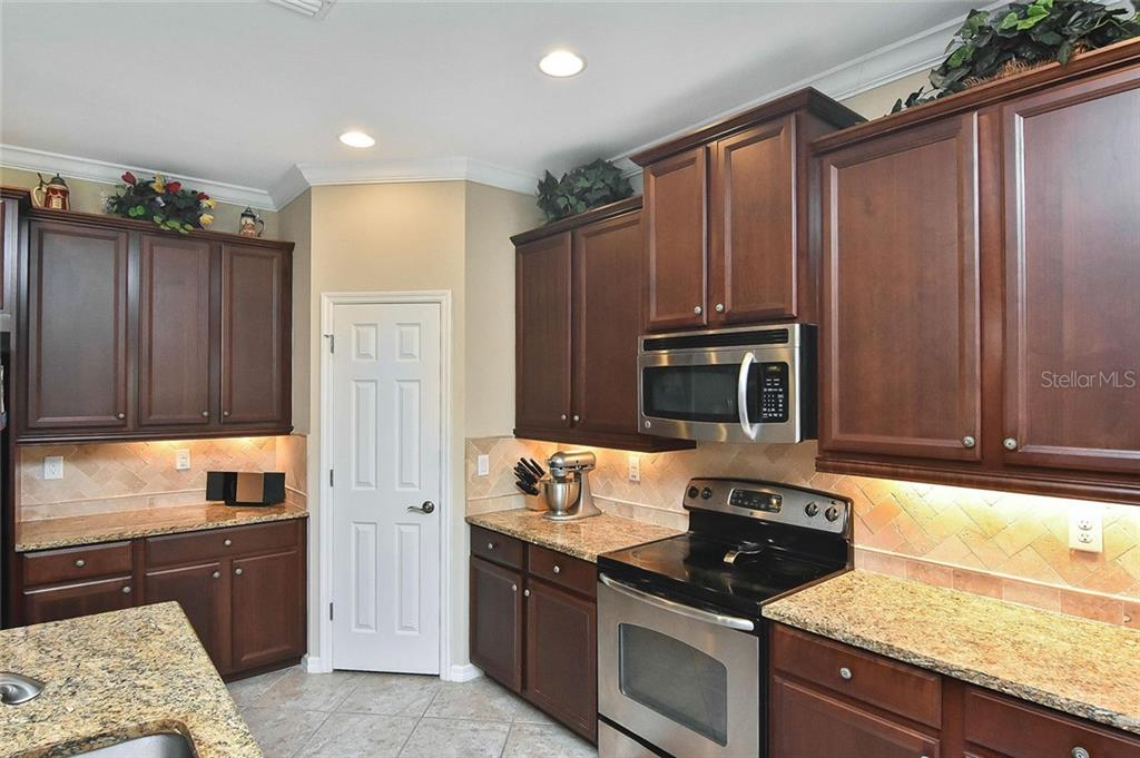 Kitchen - Single Family Home for sale at 5093 Layton Dr, Venice, FL 34293 - MLS Number is N6109788