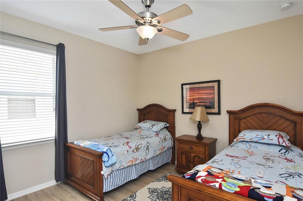 Bedroom 3 - Single Family Home for sale at 5093 Layton Dr, Venice, FL 34293 - MLS Number is N6109788