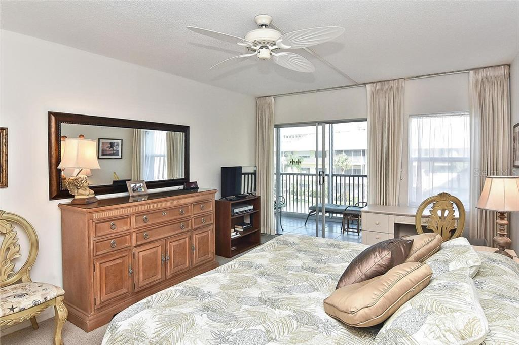 Master bedroom with sliders to lanai - Condo for sale at 1150 Tarpon Center Dr #303, Venice, FL 34285 - MLS Number is N6110126