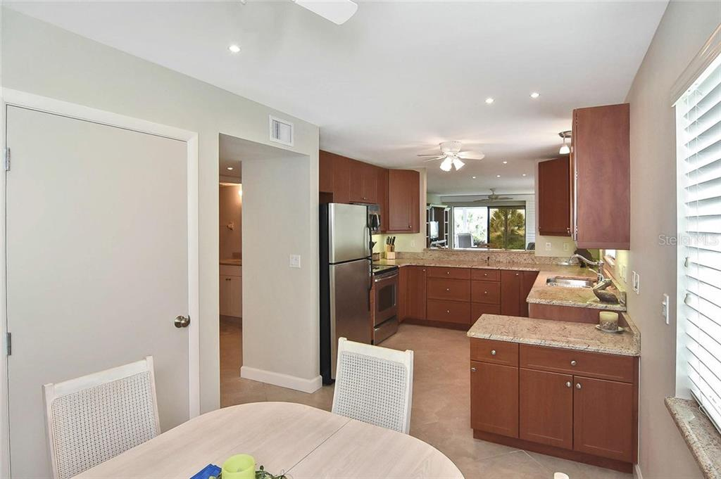 Dinette to kitchen - Condo for sale at 862 Golden Beach Blvd #862, Venice, FL 34285 - MLS Number is N6110157