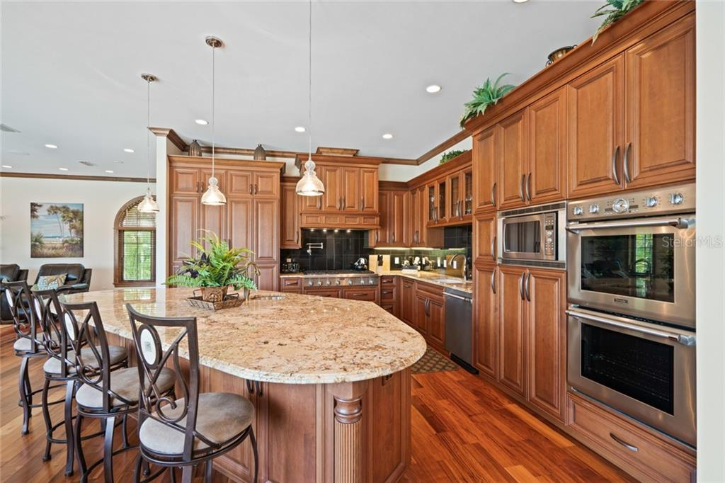 Center island with Bar stools, Beautiful raise wood cabinetry. - Single Family Home for sale at 510 Bowsprit Ln, Longboat Key, FL 34228 - MLS Number is N6110334