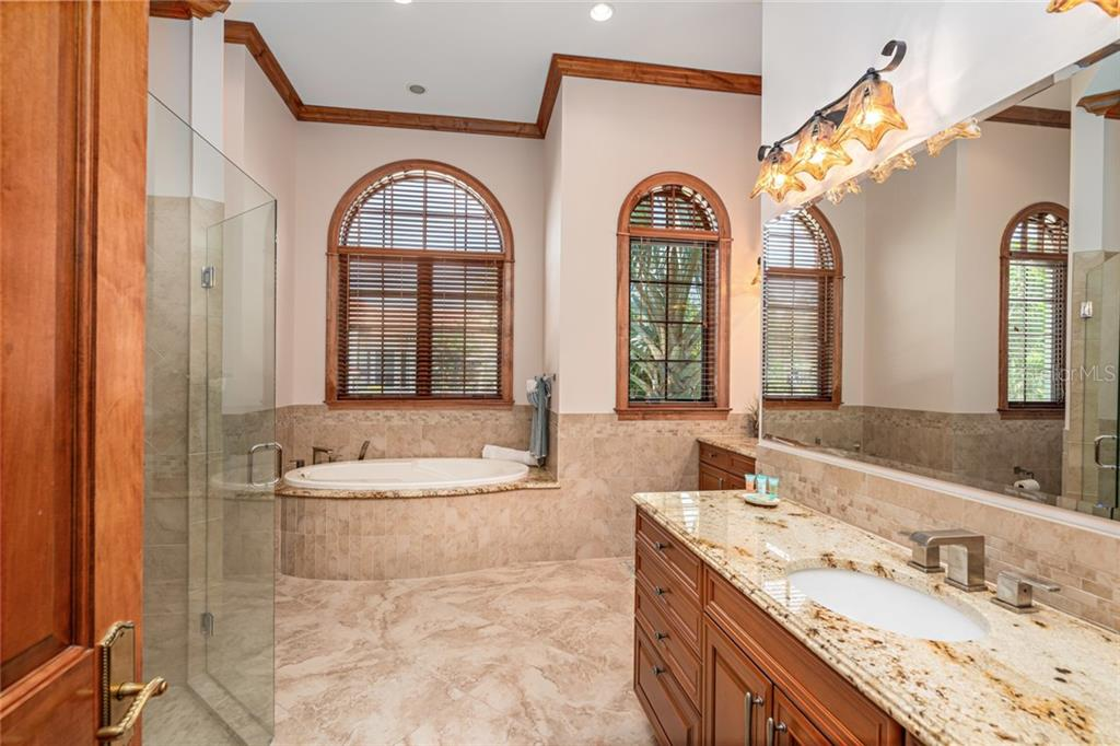 First Floor Master Bath with raised dual vanities - Single Family Home for sale at 510 Bowsprit Ln, Longboat Key, FL 34228 - MLS Number is N6110334