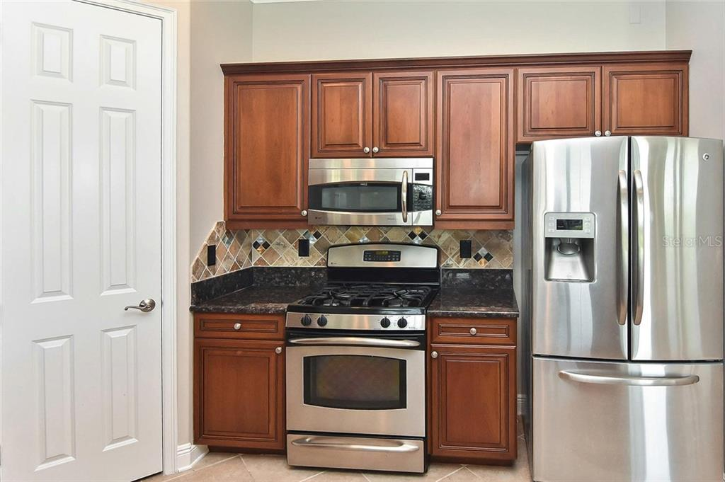 Kitchen - Single Family Home for sale at 193 Medici Ter, North Venice, FL 34275 - MLS Number is N6110365