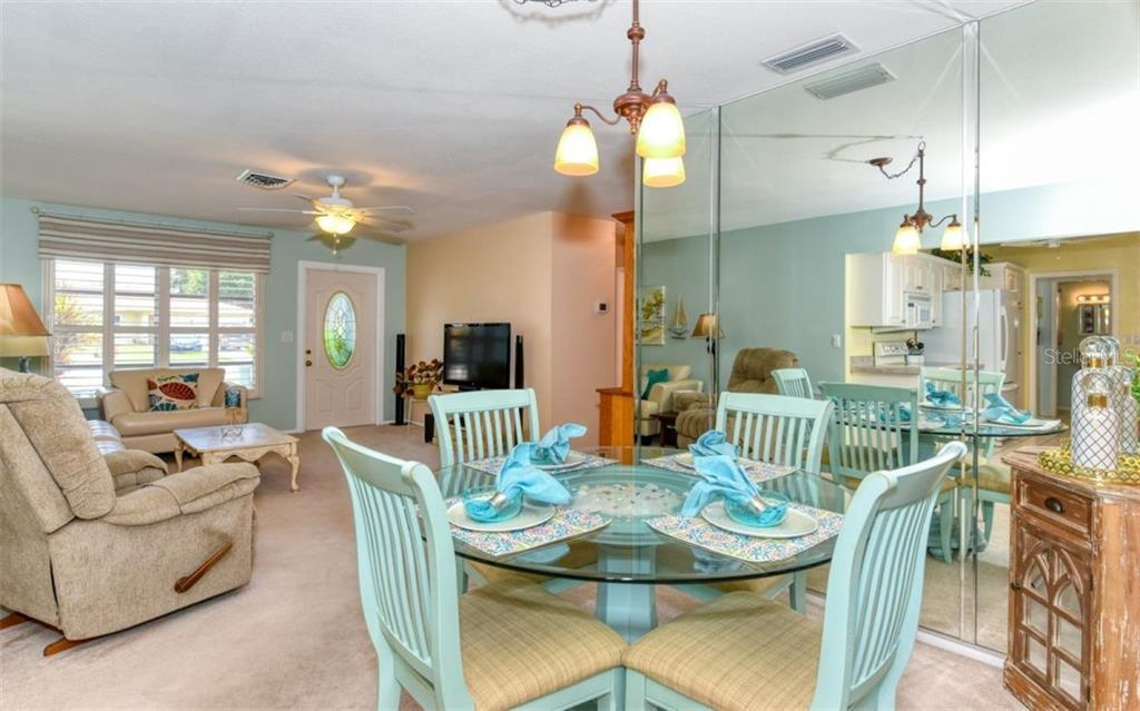 Dining room, living room - Single Family Home for sale at 404 Gulf Breeze Blvd, Venice, FL 34293 - MLS Number is N6110481