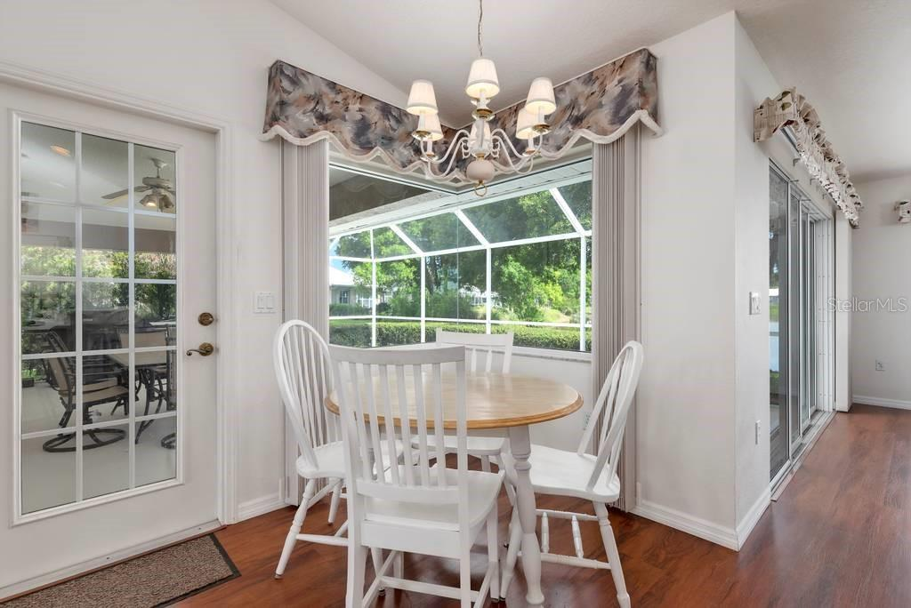 Dinette with door to lanai - Single Family Home for sale at 498 Pine Lily Way, Venice, FL 34293 - MLS Number is N6110849