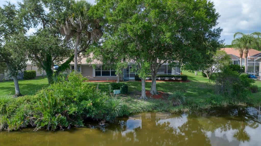 Rear exterior, lake - Single Family Home for sale at 498 Pine Lily Way, Venice, FL 34293 - MLS Number is N6110849