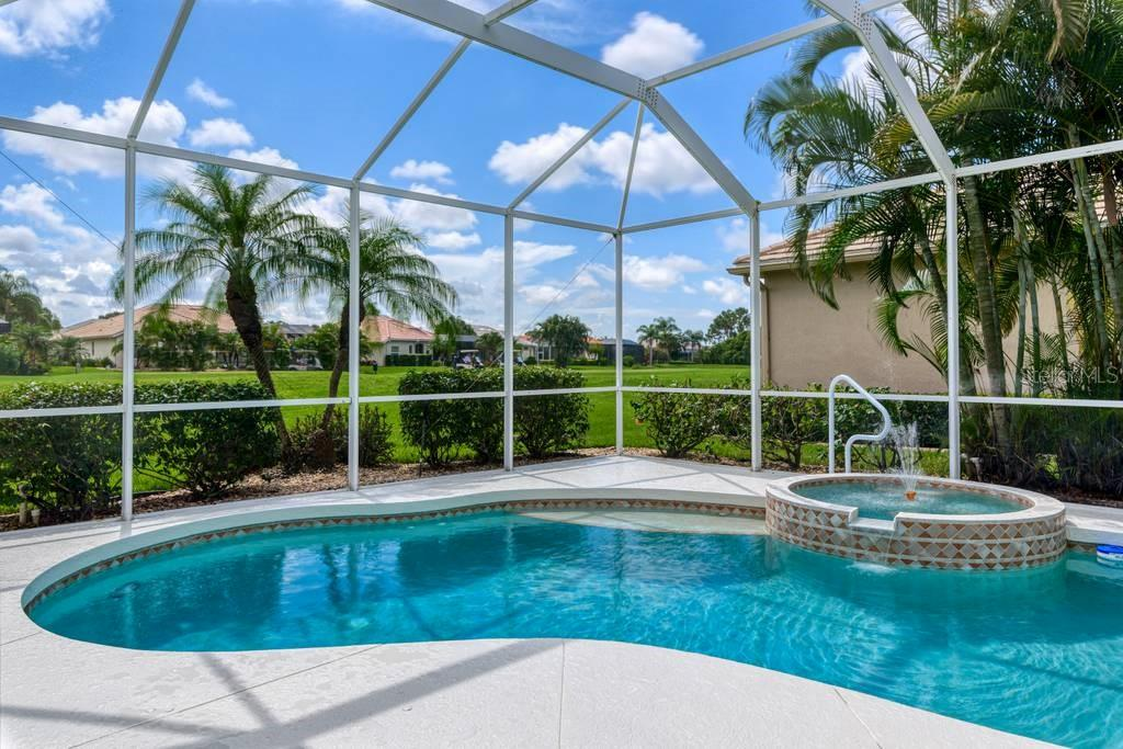 Pool/spa with view of 5th hole of The Meadows Course - Single Family Home for sale at 601 Cockatoo Cir, Venice, FL 34285 - MLS Number is N6111658