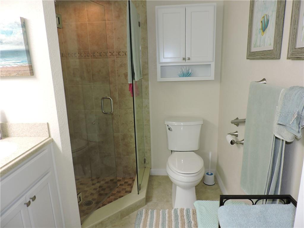 Master Beth /Shower and raised vanity - Condo for sale at 1041 Capri Isles Blvd #121, Venice, FL 34292 - MLS Number is N6112042