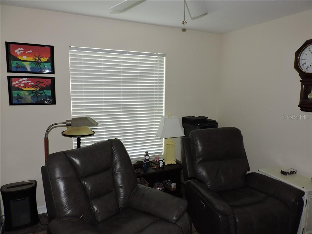 3rd Bedroom used as a TV room - Condo for sale at 1041 Capri Isles Blvd #121, Venice, FL 34292 - MLS Number is N6112042