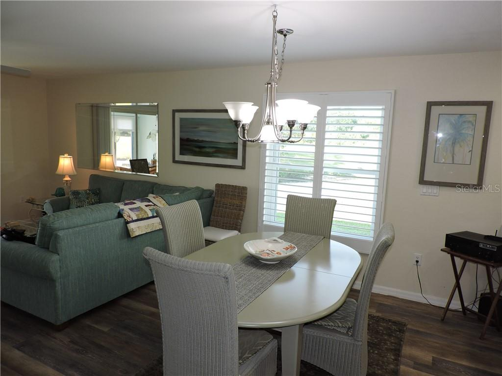 Dining Area /Living Room View - Condo for sale at 1041 Capri Isles Blvd #121, Venice, FL 34292 - MLS Number is N6112042