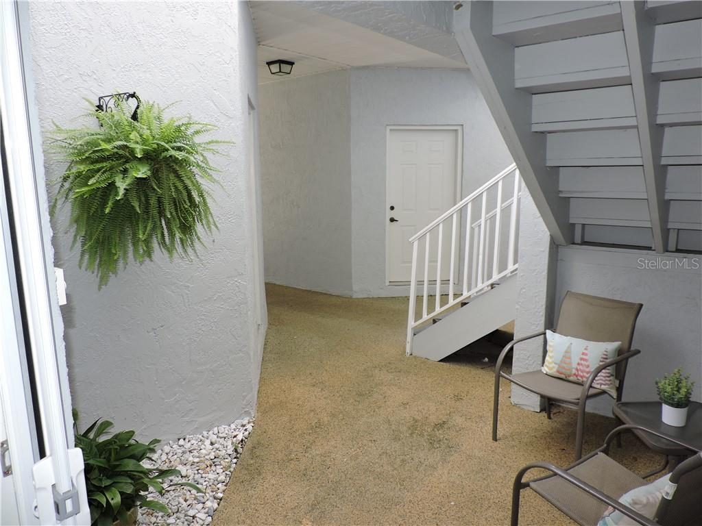 Looking out the front door/ seating area - Condo for sale at 1041 Capri Isles Blvd #121, Venice, FL 34292 - MLS Number is N6112042