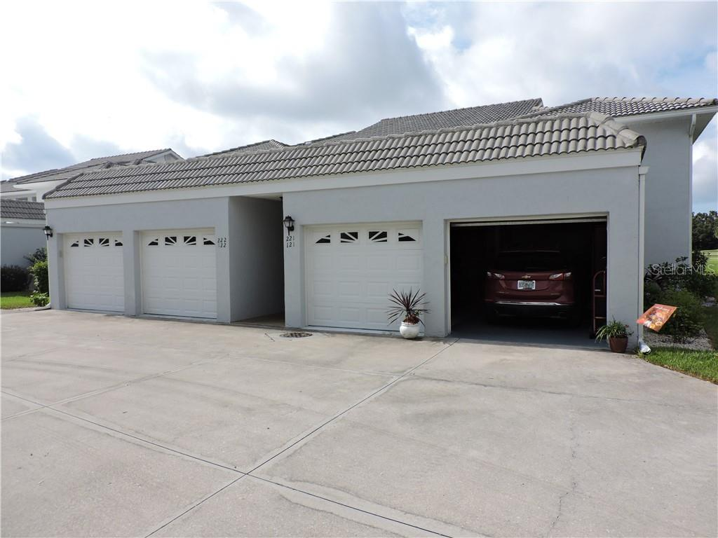 View of garage - Condo for sale at 1041 Capri Isles Blvd #121, Venice, FL 34292 - MLS Number is N6112042