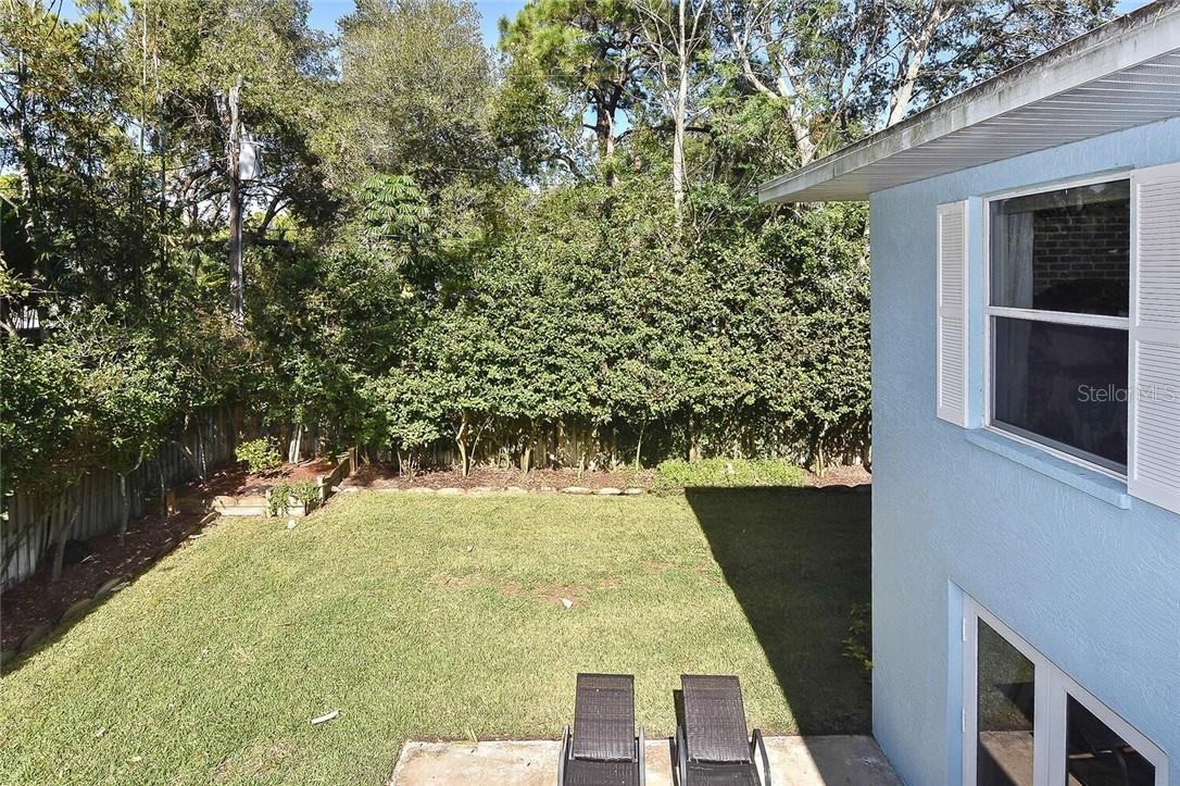 View of yard from deck - Single Family Home for sale at 608 Armada Rd S, Venice, FL 34285 - MLS Number is N6112900