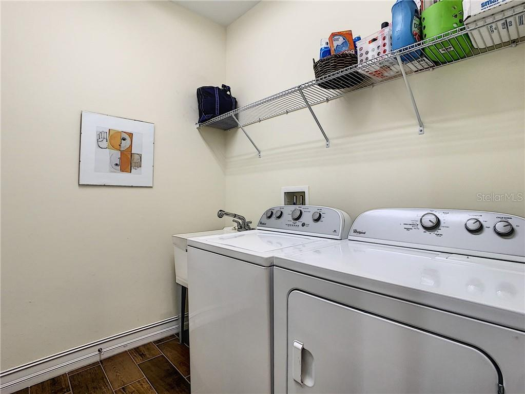 Laundry room - Single Family Home for sale at 108 Maraviya Blvd, North Venice, FL 34275 - MLS Number is N6113946