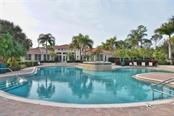 Clubhouse/community pool - Single Family Home for sale at 293 Marsh Creek Rd, Venice, FL 34292 - MLS Number is N5914238