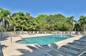 Community pool - Single Family Home for sale at 9124 Coachman Dr, Venice, FL 34293 - MLS Number is N5914408