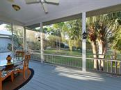 Back Screened Porch overlooking an oversized fenced-in lot with endless possibilities. - Single Family Home for sale at 200 Sunrise Dr, Nokomis, FL 34275 - MLS Number is N5914820