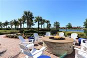 Community fire pit and lovely views - Single Family Home for sale at 13880 Lido St, Venice, FL 34293 - MLS Number is N5917319
