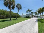 Front View/Long Driveway - Single Family Home for sale at 199 Bayview Pkwy, Nokomis, FL 34275 - MLS Number is N6100311