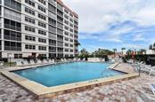 Community pool - Condo for sale at 232 Saint Augustine Ave #405, Venice, FL 34285 - MLS Number is N6101830