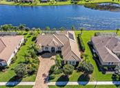 Aerial front with lake - Single Family Home for sale at 19799 Cobblestone Cir, Venice, FL 34292 - MLS Number is N6104694