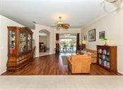 Living room with sliders to lanai/pool - Single Family Home for sale at 129 Wayforest Dr, Venice, FL 34292 - MLS Number is N6105216