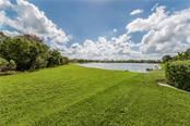 View of Lake from Lanai - Single Family Home for sale at 262 Pesaro Dr, North Venice, FL 34275 - MLS Number is N6107589