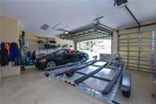 Garage Interior. - Single Family Home for sale at 2560 Pebble Creek Pl, Port Charlotte, FL 33948 - MLS Number is N6109100