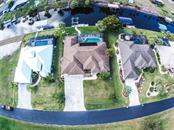 Aerial of home showing dock and canal. - Single Family Home for sale at 2560 Pebble Creek Pl, Port Charlotte, FL 33948 - MLS Number is N6109100