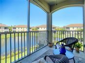 View of Pond from the Lanai - Condo for sale at 3211 Oriole Dr #104, Sarasota, FL 34243 - MLS Number is N6109438