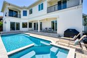 Sensational Heated Pool  and sun deck - Single Family Home for sale at 510 Bowsprit Ln, Longboat Key, FL 34228 - MLS Number is N6110334