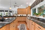 Kitchen - Single Family Home for sale at 725 Eagle Point Dr, Venice, FL 34285 - MLS Number is N6111842