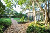 Path to main house and guest house - Single Family Home for sale at 161 & 181 Gilchrist Ave, Boca Grande, FL 33921 - MLS Number is D5915030