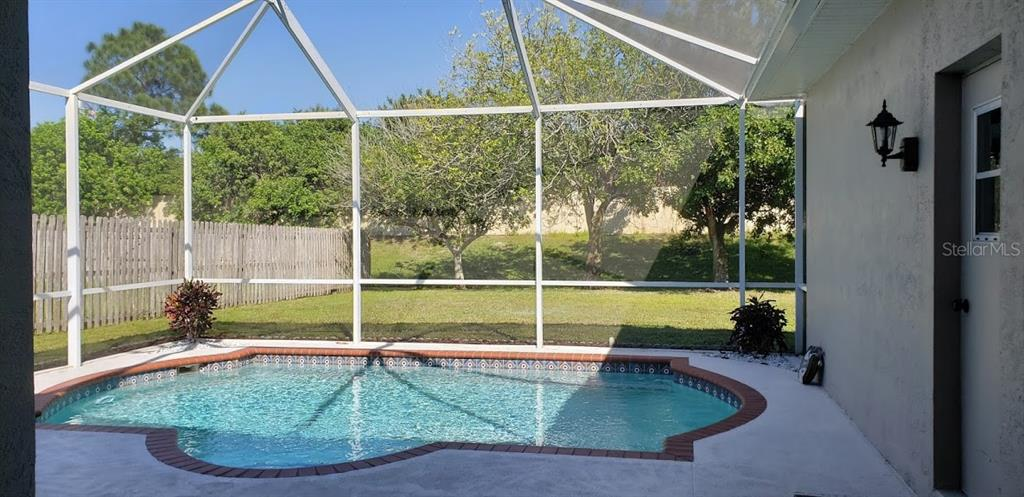 Pool and screen view - Single Family Home for sale at 4945 79th St E, Bradenton, FL 34203 - MLS Number is T3163646