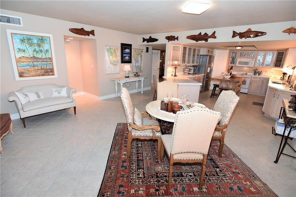 Panoramic view of: Foyer, Bedroom entrance, Dining area and Kitchen - Condo for sale at 3210 Southshore Dr #11a, Punta Gorda, FL 33955 - MLS Number is C7402449