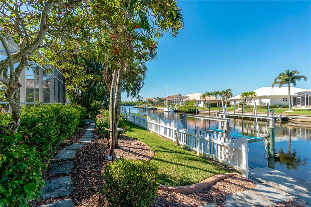 Fenced Backyard and beautiful walk ways! - Single Family Home for sale at 1309 Casey Key Dr, Punta Gorda, FL 33950 - MLS Number is C7413790