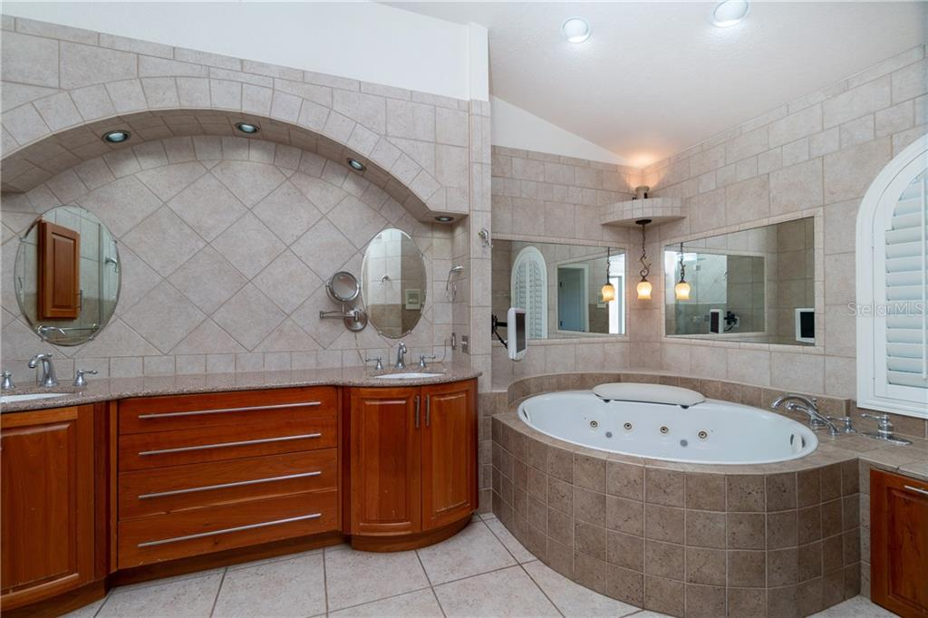 Wow factor best describes this elegant spa master bath. double sinks, silestone counters,beautiful cherry wood cabinets and tiled walls. - Single Family Home for sale at 1309 Casey Key Dr, Punta Gorda, FL 33950 - MLS Number is C7413790