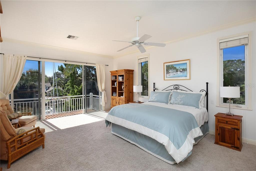 Master Bedroom with Oversized Sliding Doors to Balcony, Dual Walk-in Closets, & Volume Ceilings - Single Family Home for sale at 722 Siesta Dr, Sarasota, FL 34242 - MLS Number is A4169257