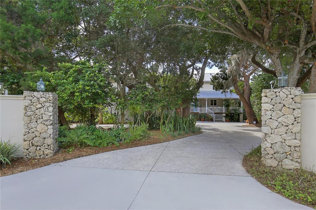 Expansive front Crushed Seashell Driveway provides abundant space for parking! - Single Family Home for sale at 722 Siesta Dr, Sarasota, FL 34242 - MLS Number is A4169257