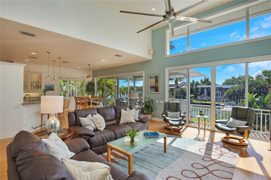 Open Living Area to Breakfast Nook & Kitchen.  Gorgeous Water Views with Natural Light, Warm Oak Flooring and Vaulted Ceilings! - Single Family Home for sale at 722 Siesta Dr, Sarasota, FL 34242 - MLS Number is A4169257