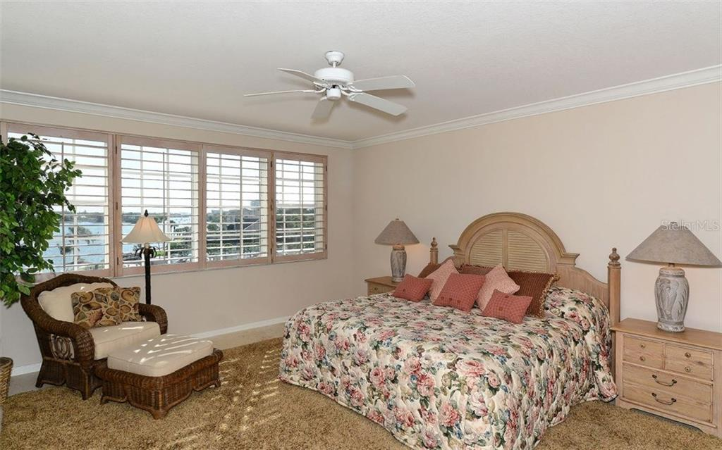 Master bedroom with bay views - Condo for sale at 1260 Dolphin Bay Way #401, Sarasota, FL 34242 - MLS Number is A4173008