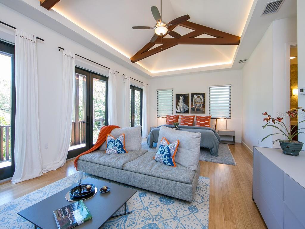 The master suite is a comfortable haven at day's end, with design elements including exposed beams, a rejuvenating steam rain shower and walk-in closet. - Single Family Home for sale at 2315 Mietaw Dr, Sarasota, FL 34239 - MLS Number is A4191514