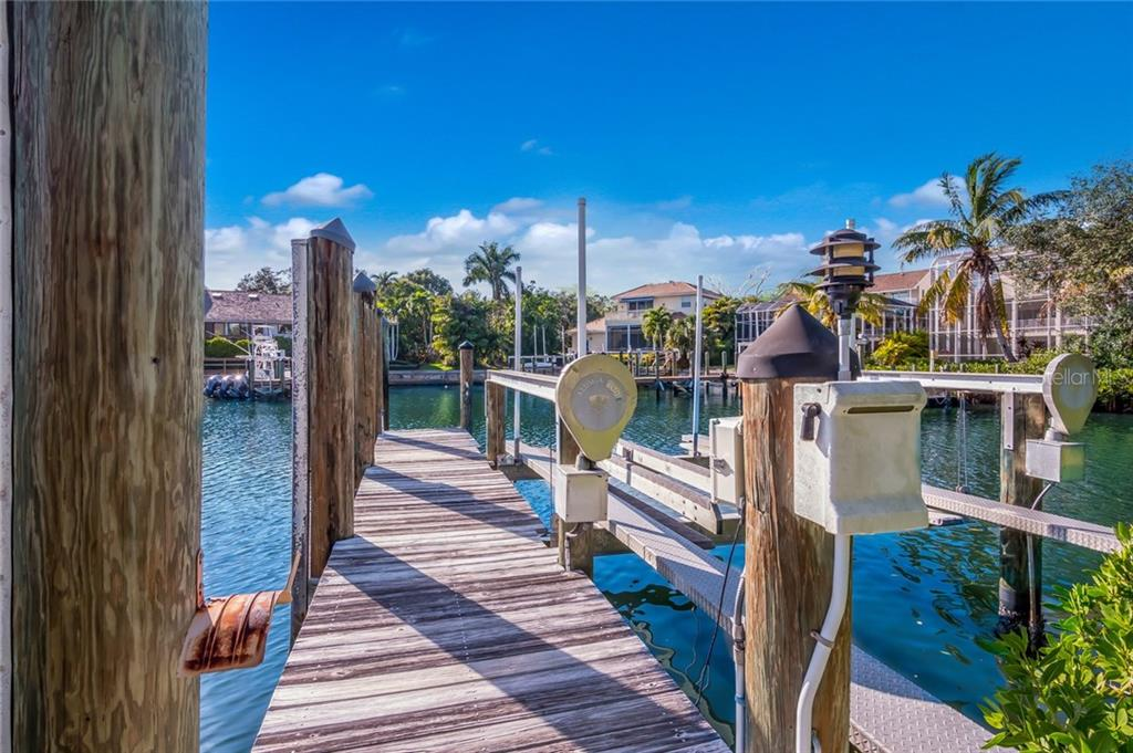 Double sided dock on protected harbor - Single Family Home for sale at 1253 Riegels Landing Dr, Sarasota, FL 34242 - MLS Number is A4203768