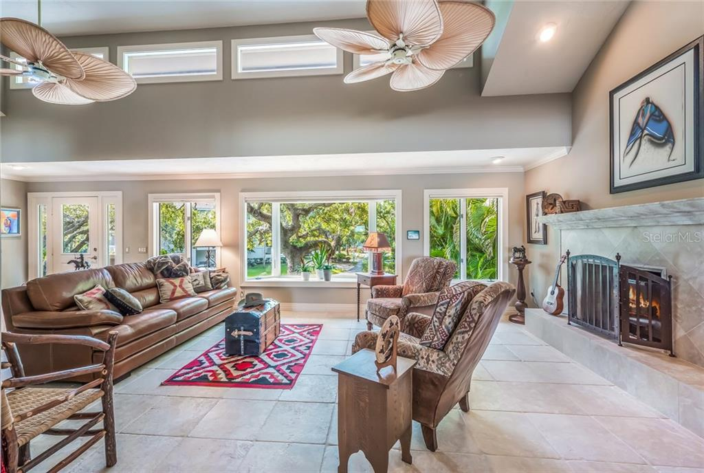 Living area with expansive windows - Single Family Home for sale at 1253 Riegels Landing Dr, Sarasota, FL 34242 - MLS Number is A4203768