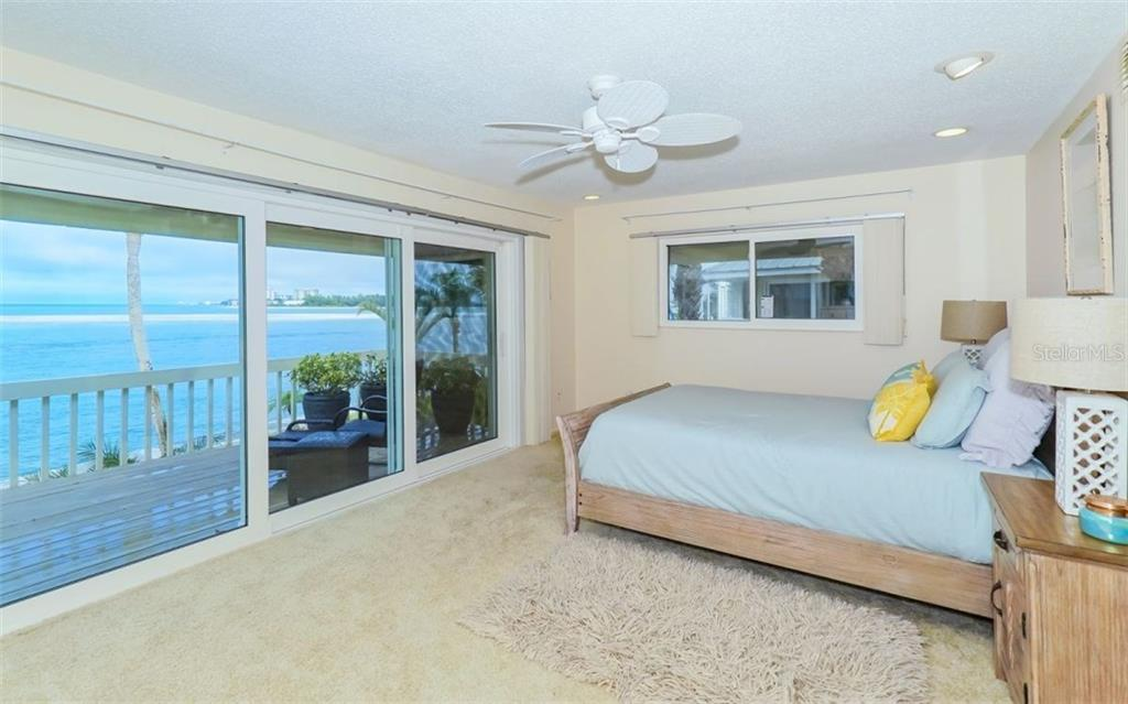 Master bedroom with sliders to porch and Gulf of Mexico views - Single Family Home for sale at 148 Sand Dollar Ln, Sarasota, FL 34242 - MLS Number is A4206505