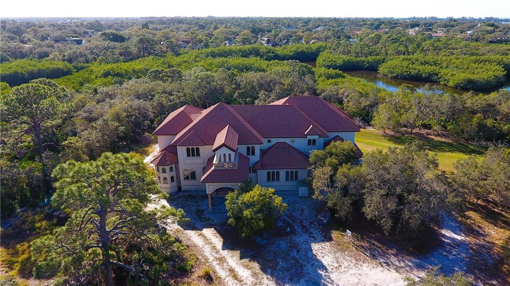 Single Family Home for sale at 105 N Point Rd, Osprey, FL 34229 - MLS Number is A4206881