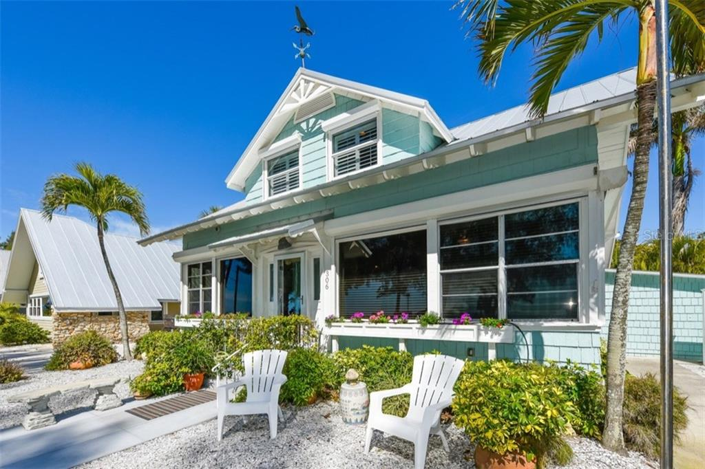 Originally built in 1912 - Miss Emma has been beautifully renovated to a grand lady! - Single Family Home for sale at 306 Gulf Blvd, Anna Maria, FL 34216 - MLS Number is A4206962