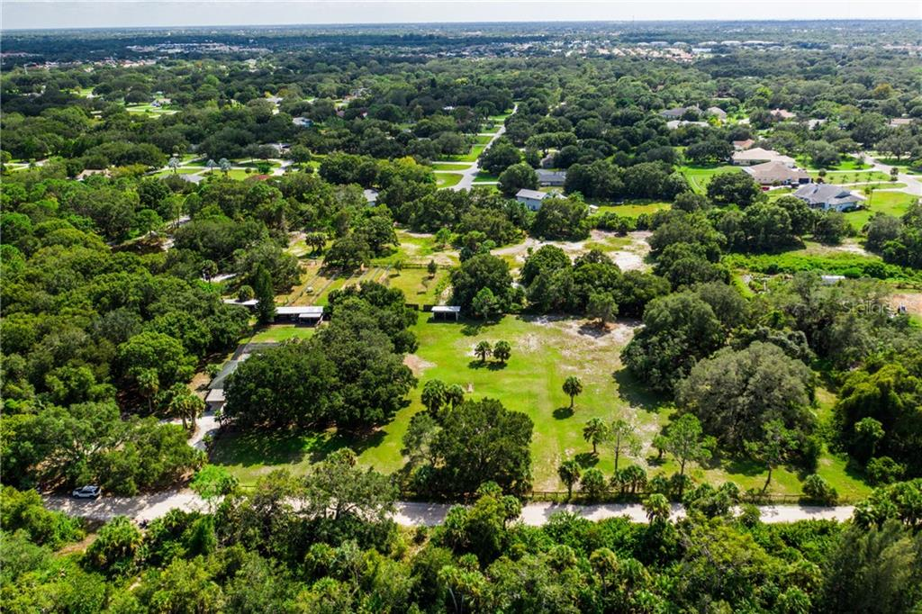 Towering Oaks shade the residence. - Single Family Home for sale at 2045 Frederick Dr, Venice, FL 34292 - MLS Number is A4416740